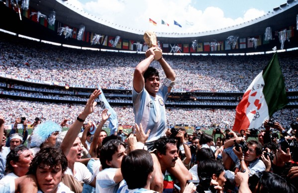 Volume 2, Page 13, Picture 4, 10234981. Sport, Football. 1986, World Cup Final, (Mexico City). Argentina Captain, Diego Maradona holds the World Cup trophy whilst being carried on his team-mates' shoulders.